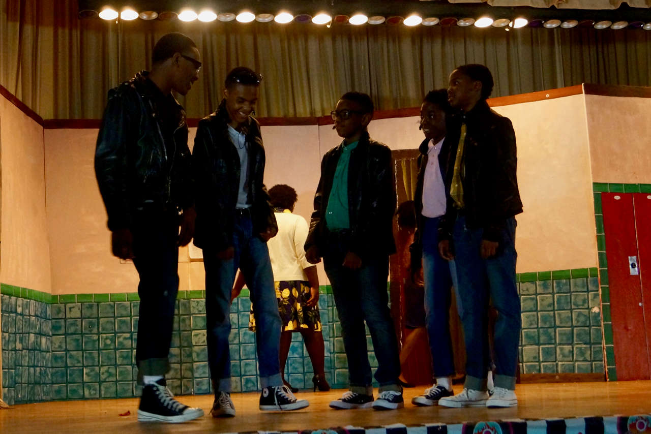 Students on stage in Grease