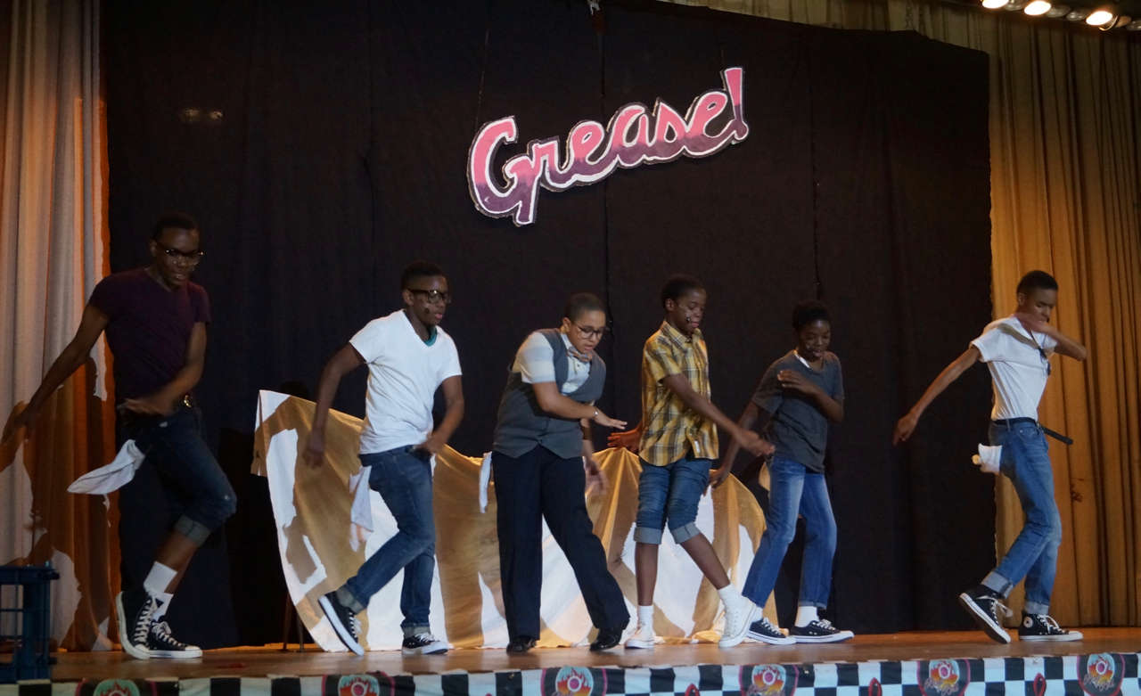 Students dancing on stage in Grease