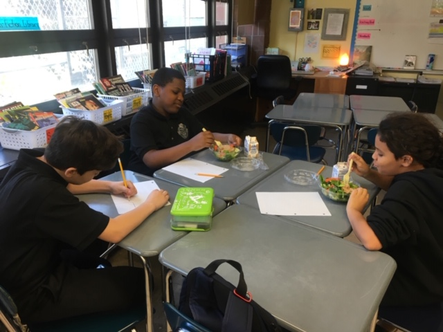 A group of students in classroom working.