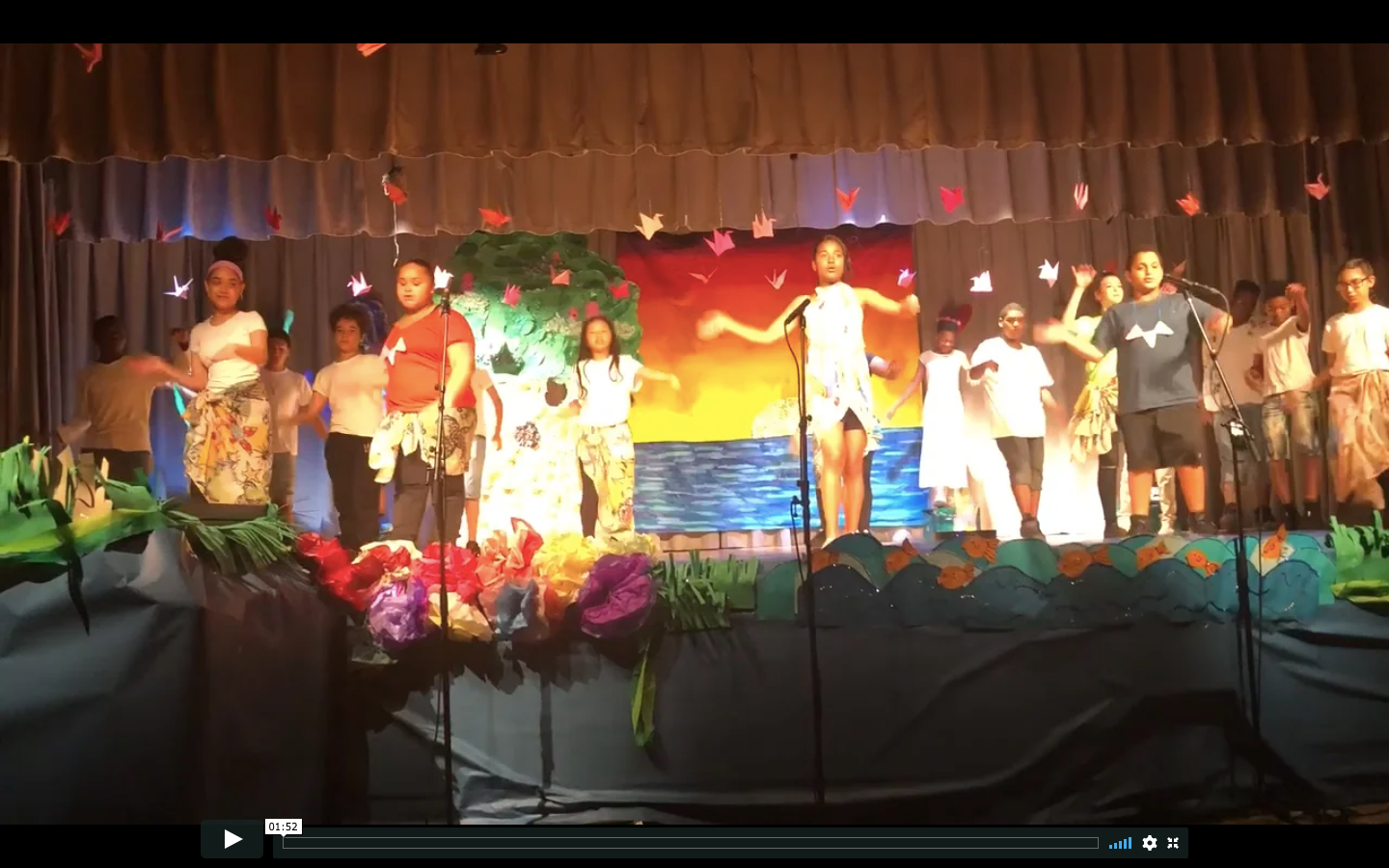 Students performing on stage.