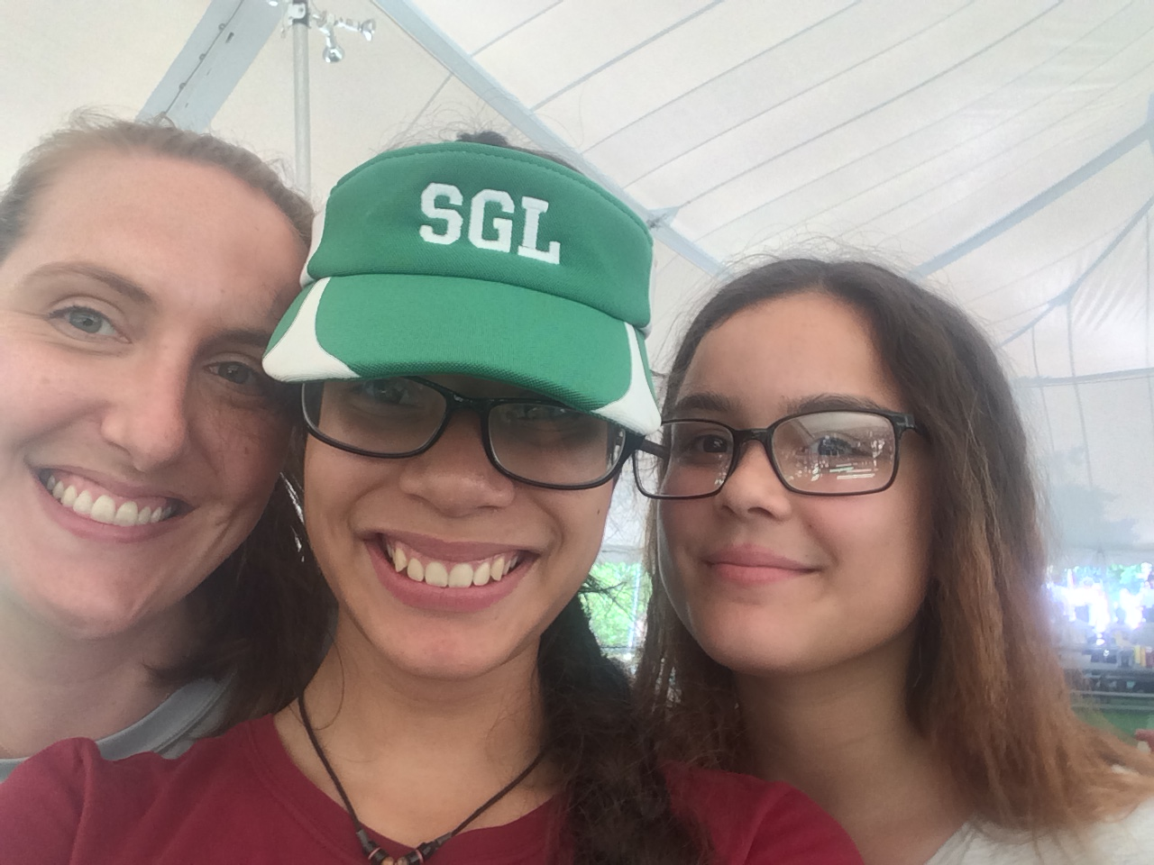A teacher and two students takes a selfie.