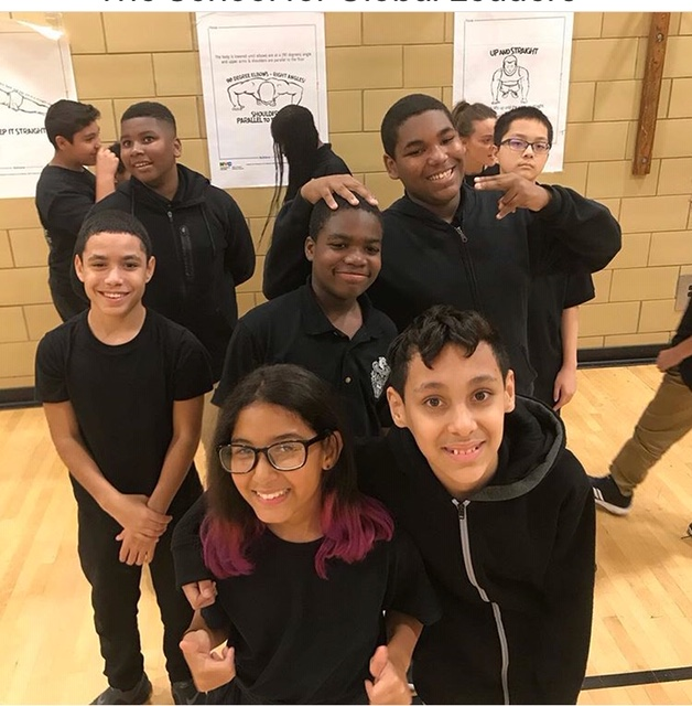 A group of ten students smiling at the camera.