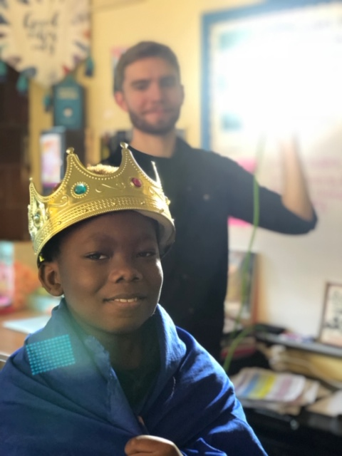 A student models a crown on his head.