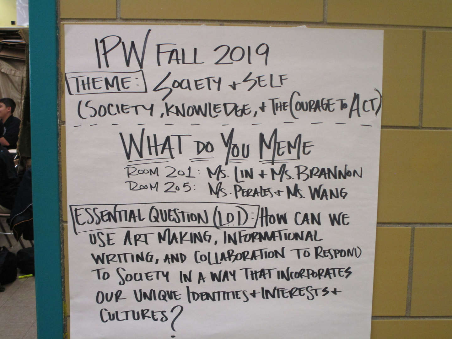 "Paper on a wall that reads ""IPW 2019""."