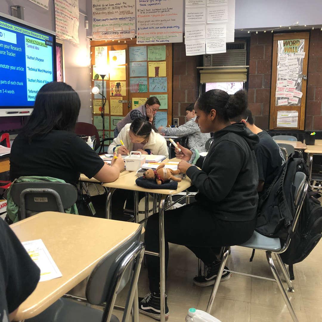 Students sitting down talking.