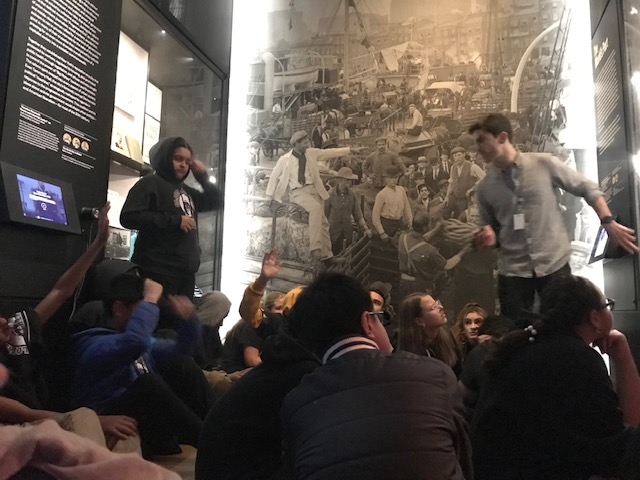 Students in a museum looking at artwork.