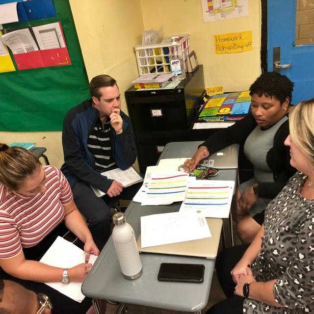 A group of teachers talking.