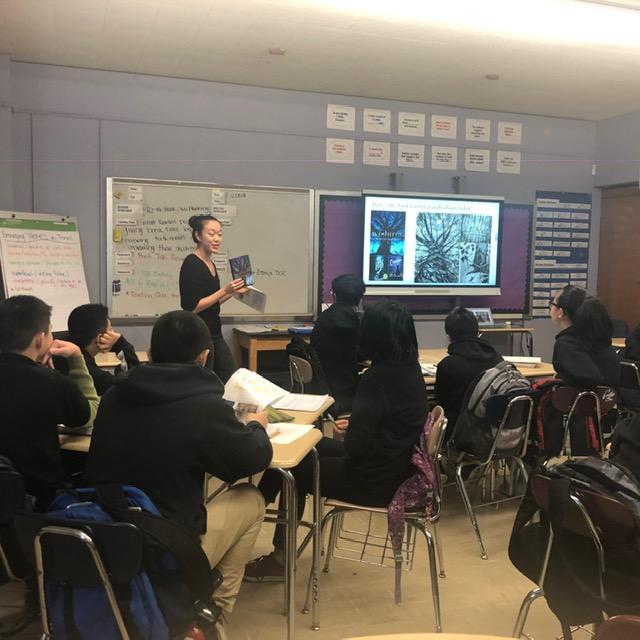 Teacher teaching class.