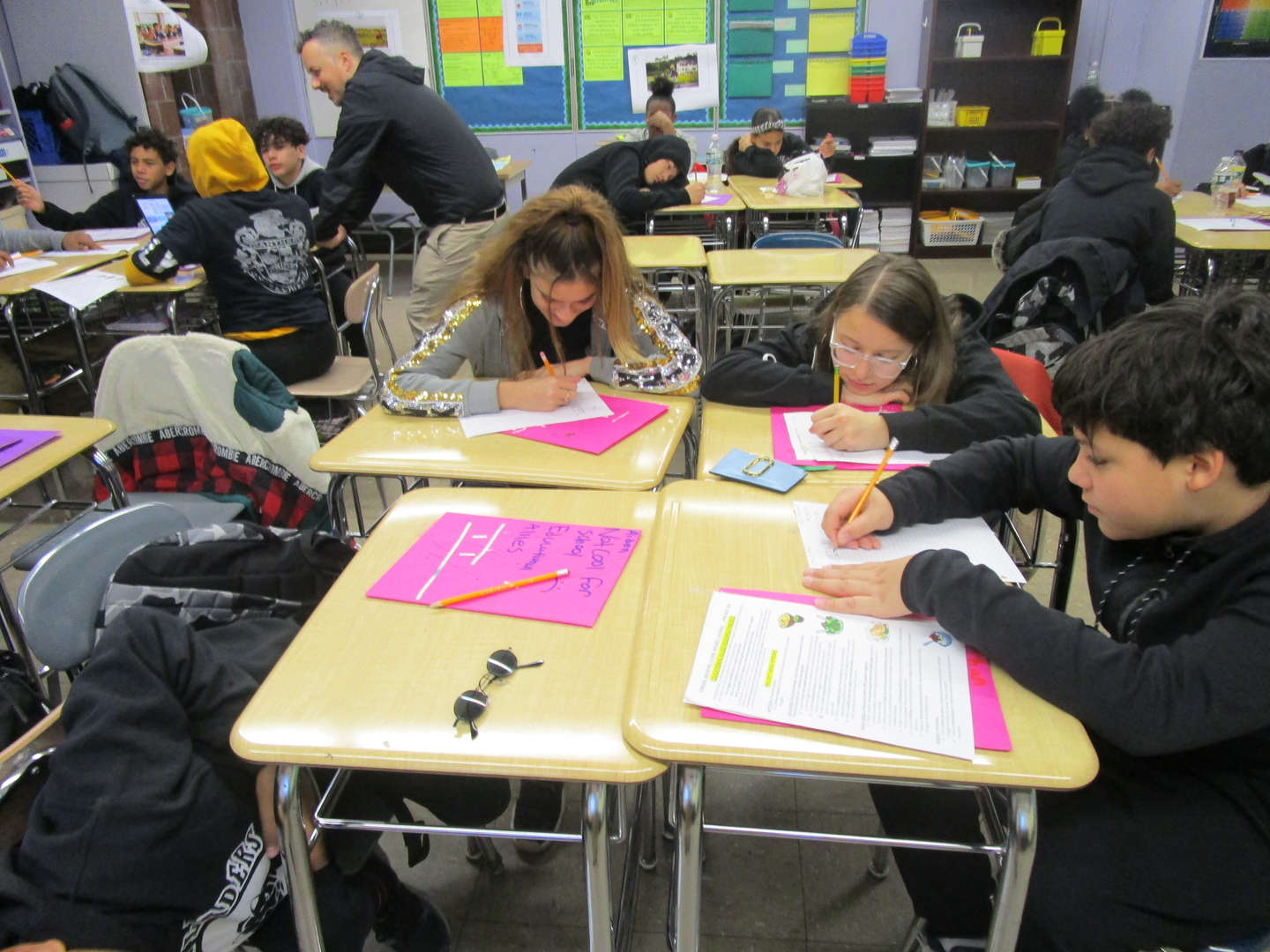 Students working together on a class assignment.