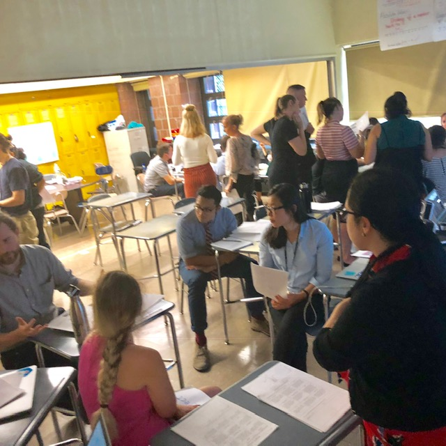 Classroom full of students looking at teacher.