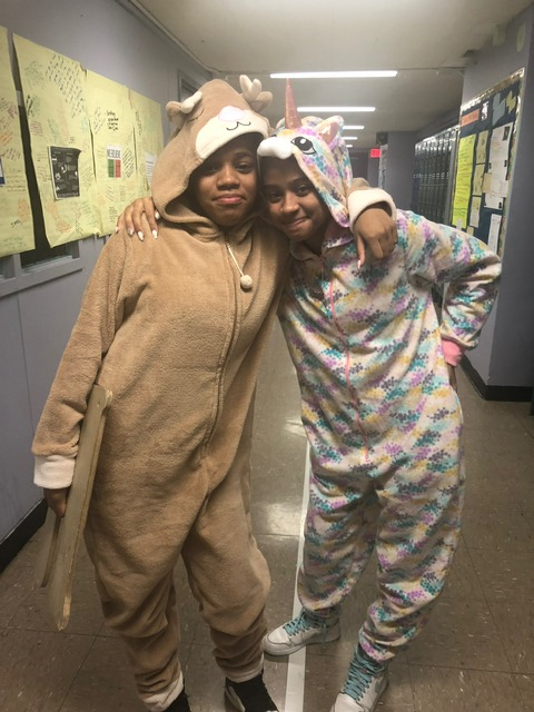 Two students pose in pajamas.