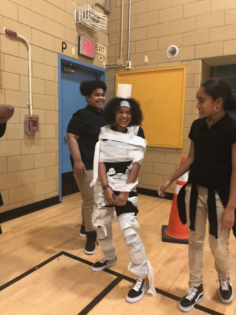A student wrapped in toilet tissue.