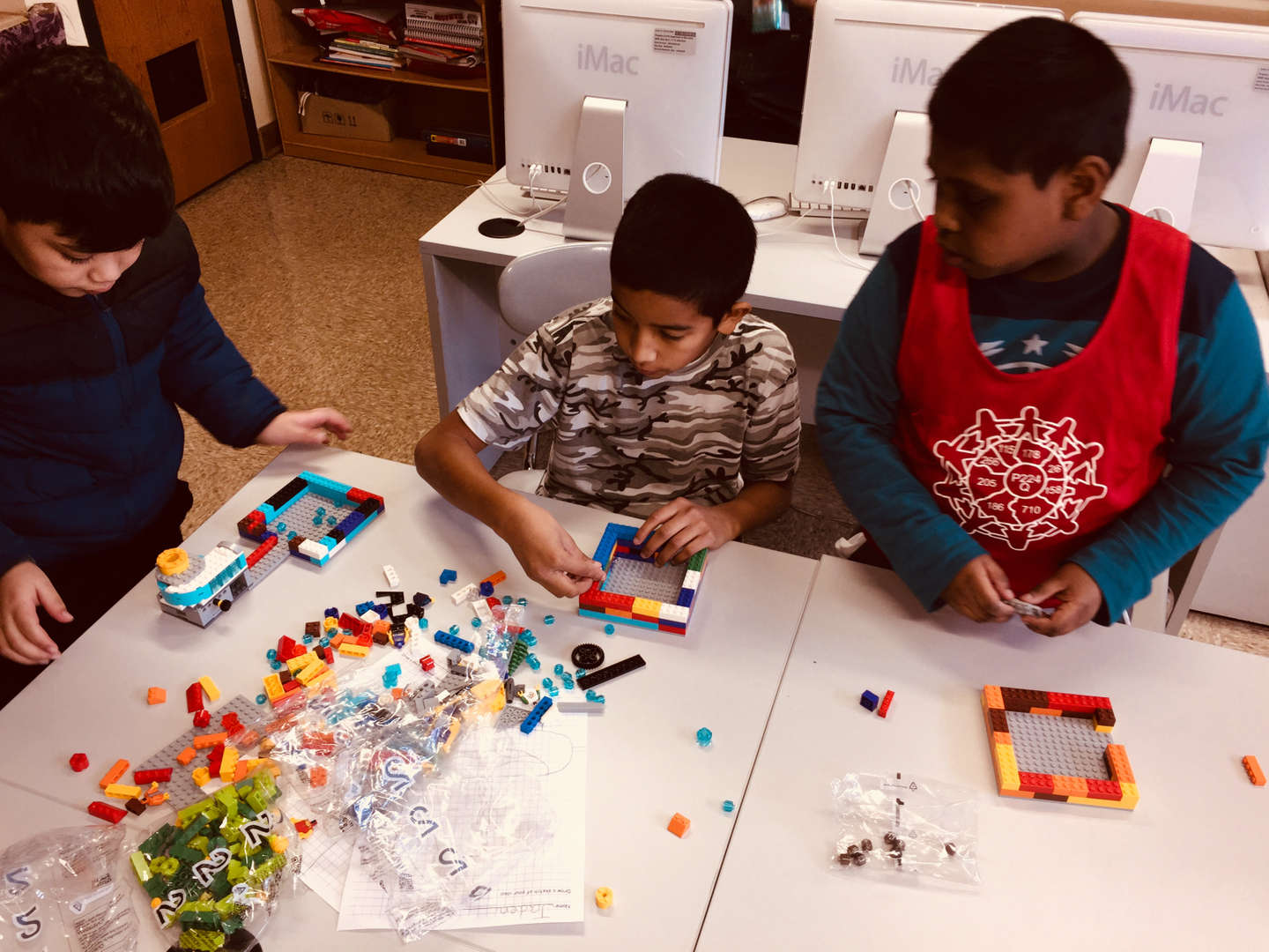 Students building with Legos for a Lego Competition.