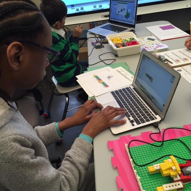 Student coding Lego program for Lego robotics.