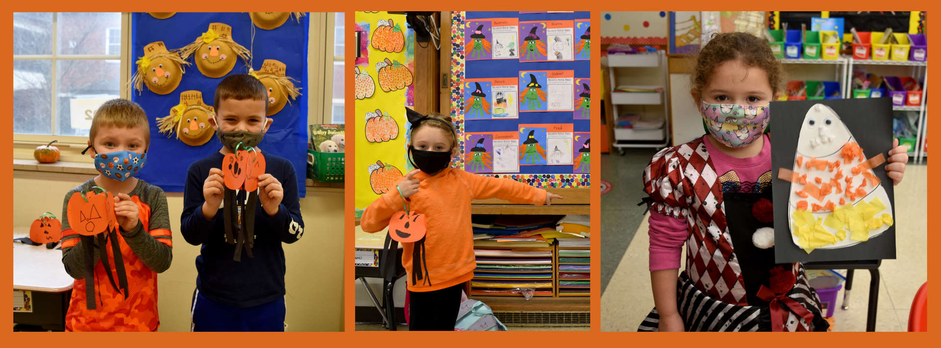 Kindergartners  pose with their Halloween crafts