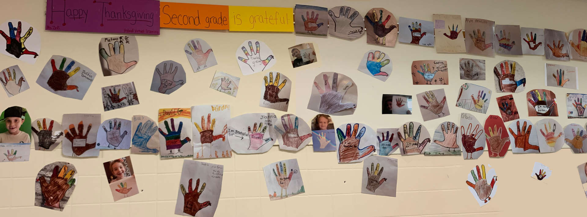 2nd grade art work covers the walls of the hallway