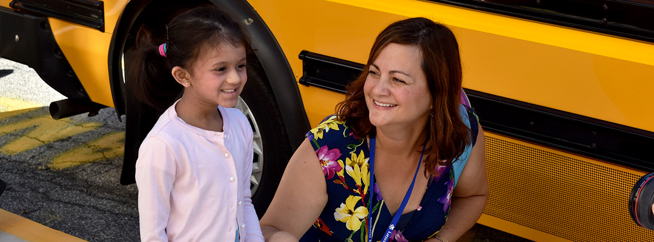 Principal smiles at girl