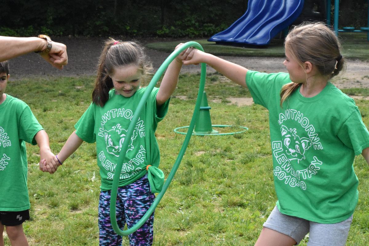 girl steps through hula hoop