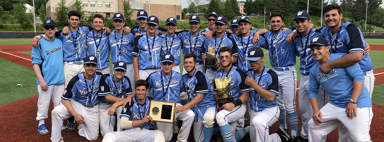 Baseball team poses with trophy