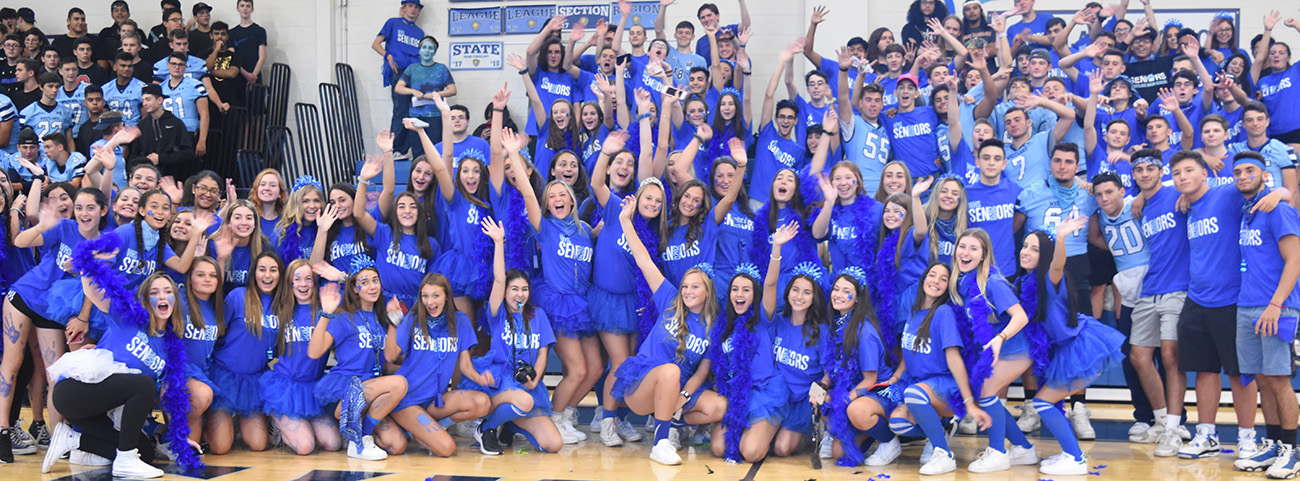 Large group of students cheer during pep rally