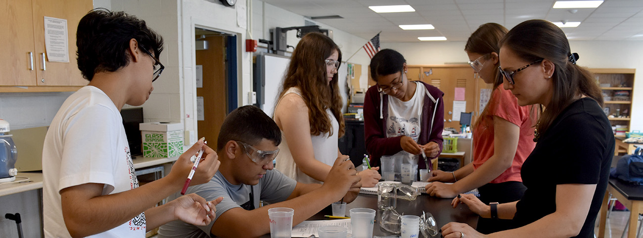 Students conduct chemistry experiments.