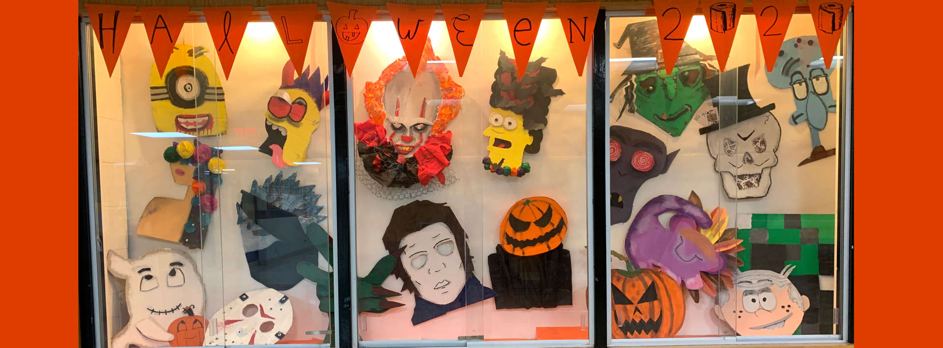 Halloween display of masks made by art students