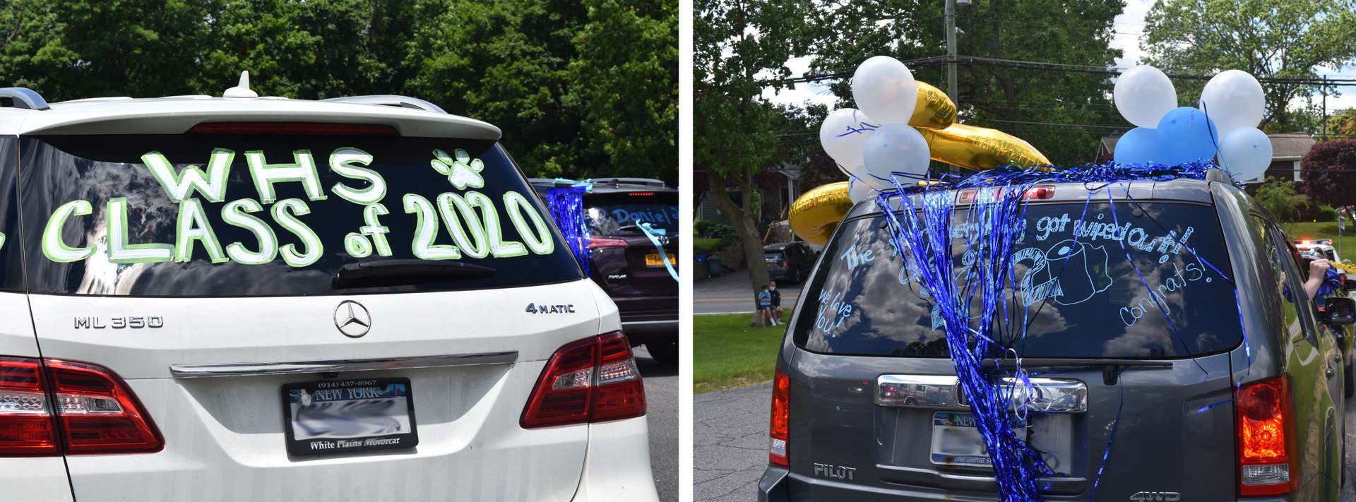two cars decorated for graduation parade