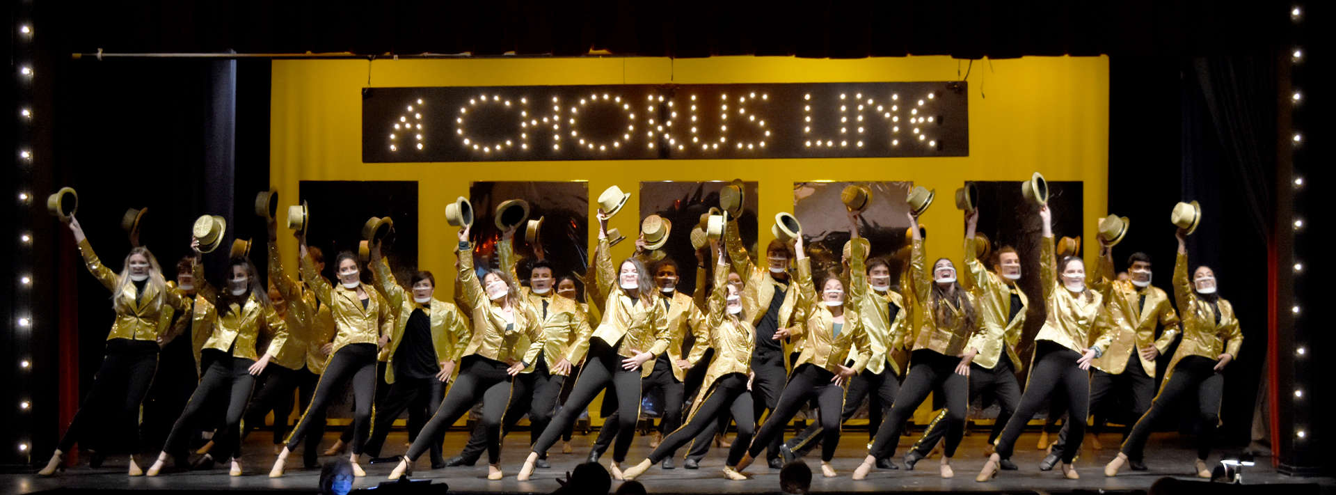 Student performers on stage for production of A Chorus Line