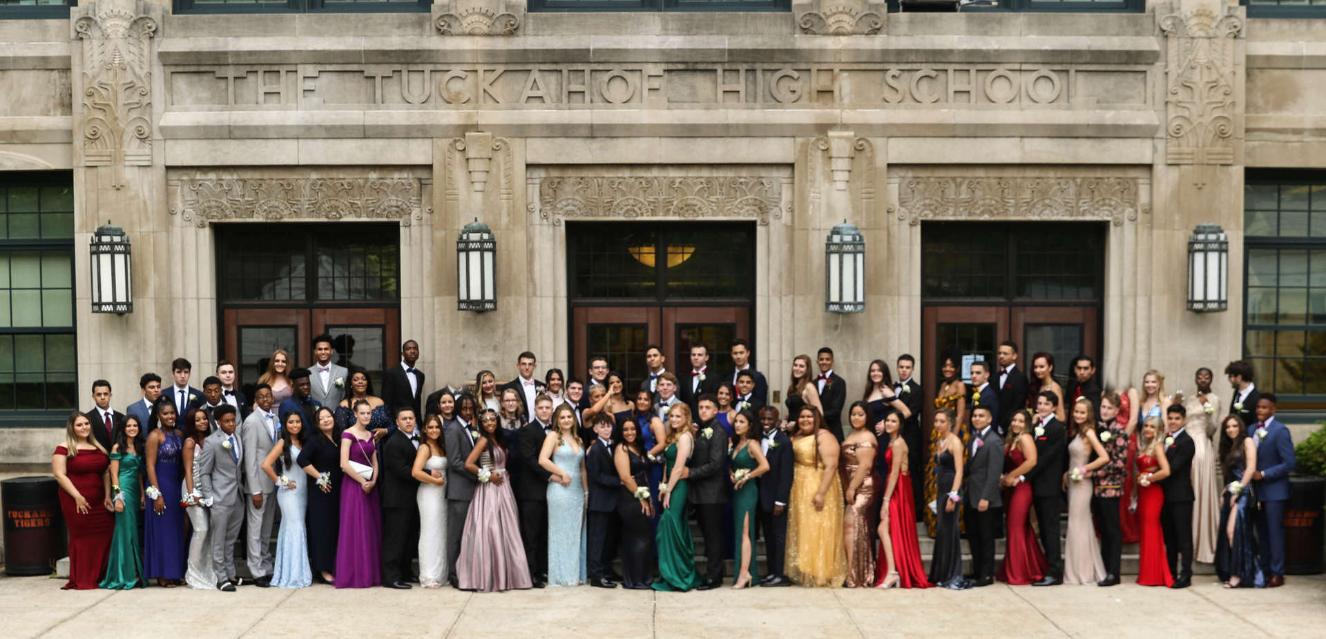 THS Seniors and their guests pose for the 2019 Prom in front of The Tuckahoe High School.