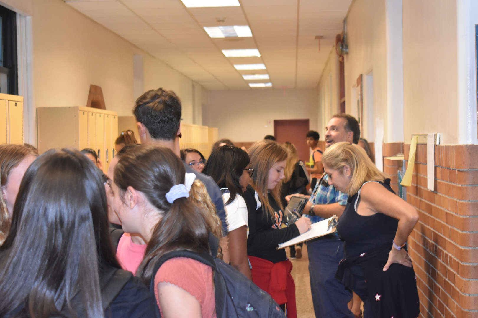 photo of students and teachers in hallway