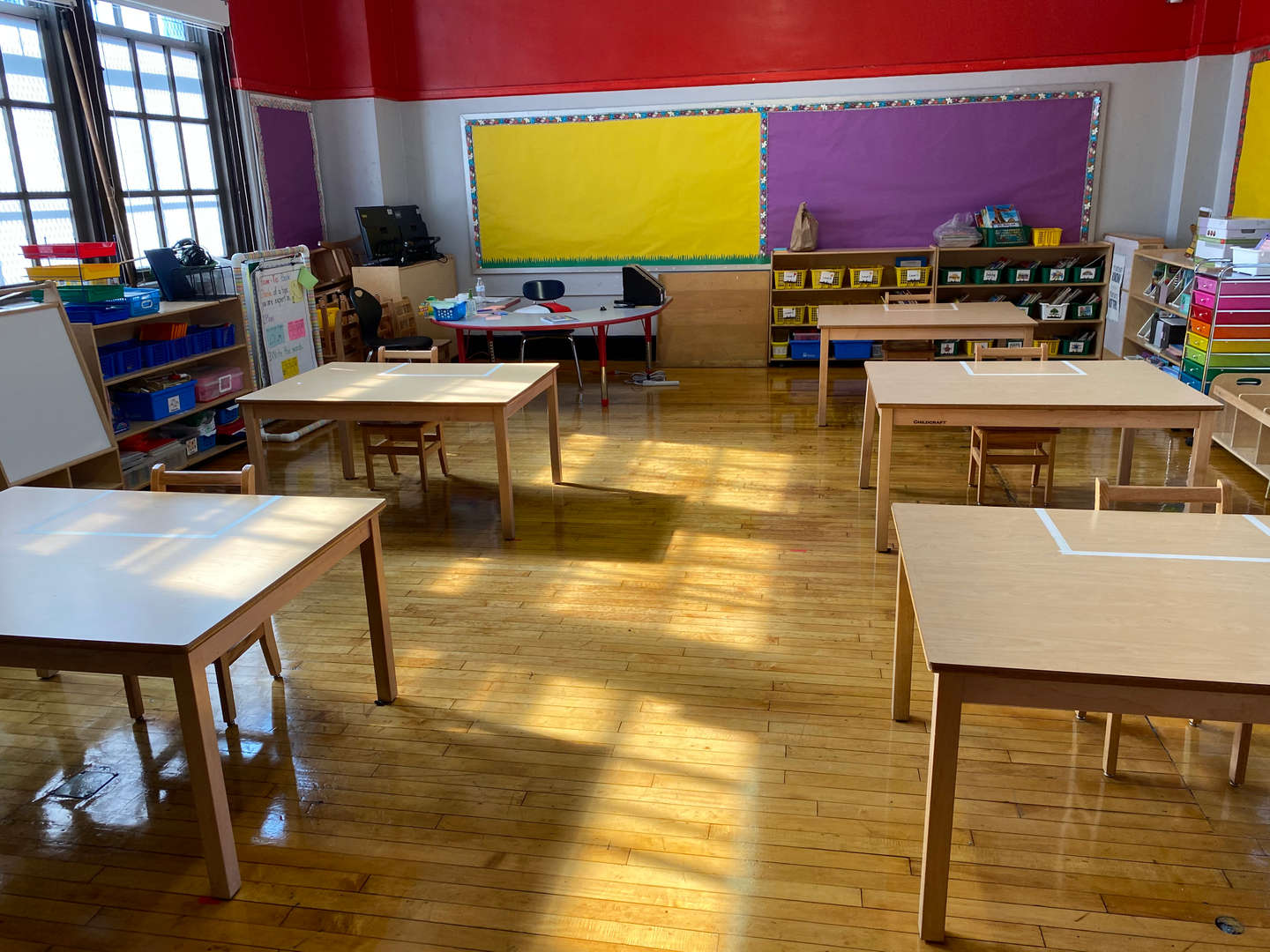 View of a clean classroom with social distancing measures in place.
