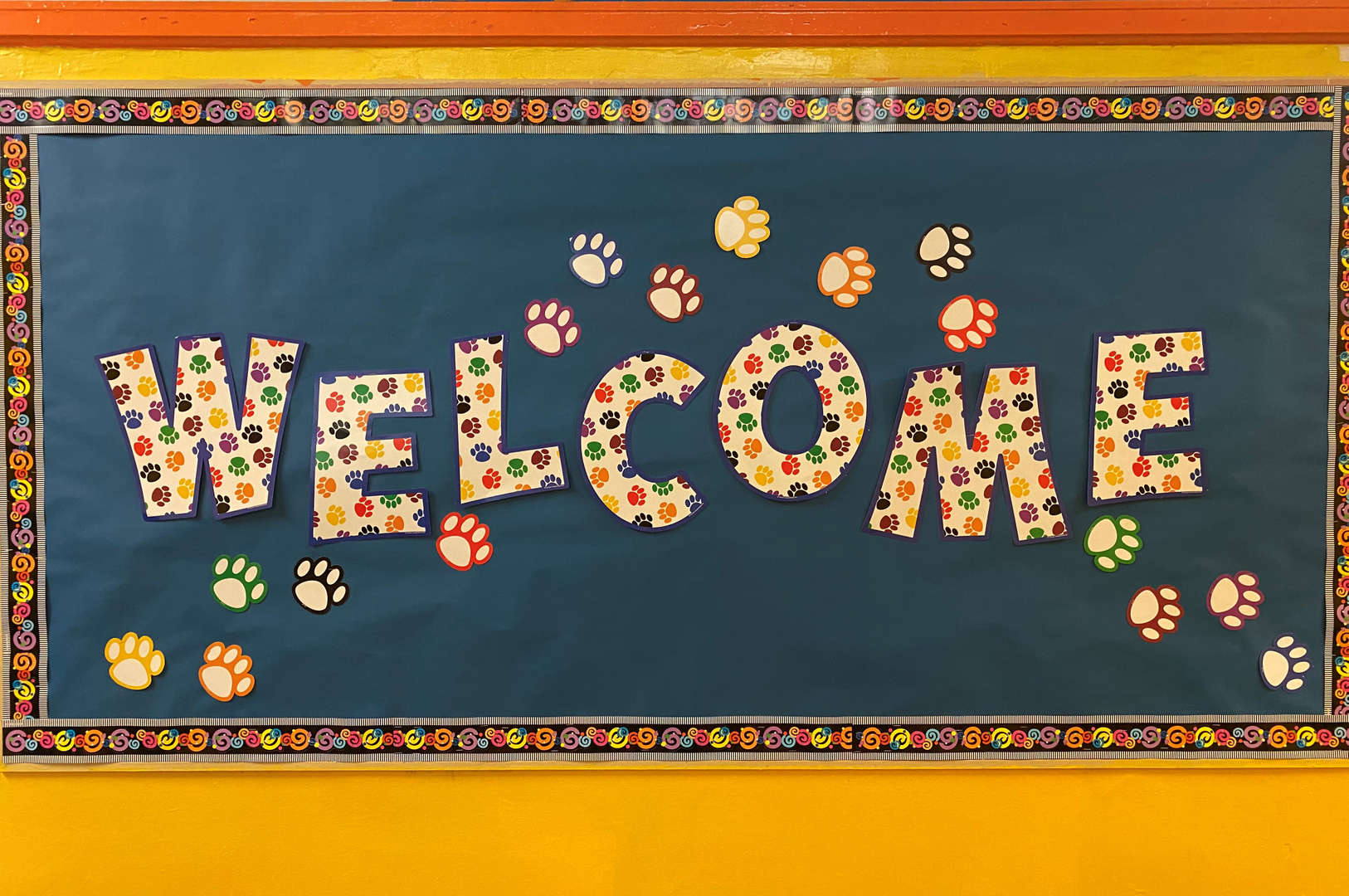 A bulletin board welcoming everyone back.