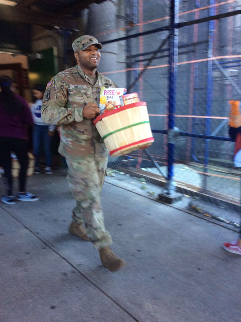 Food Basket Drive.  Soldiers delivering the baskets of food
