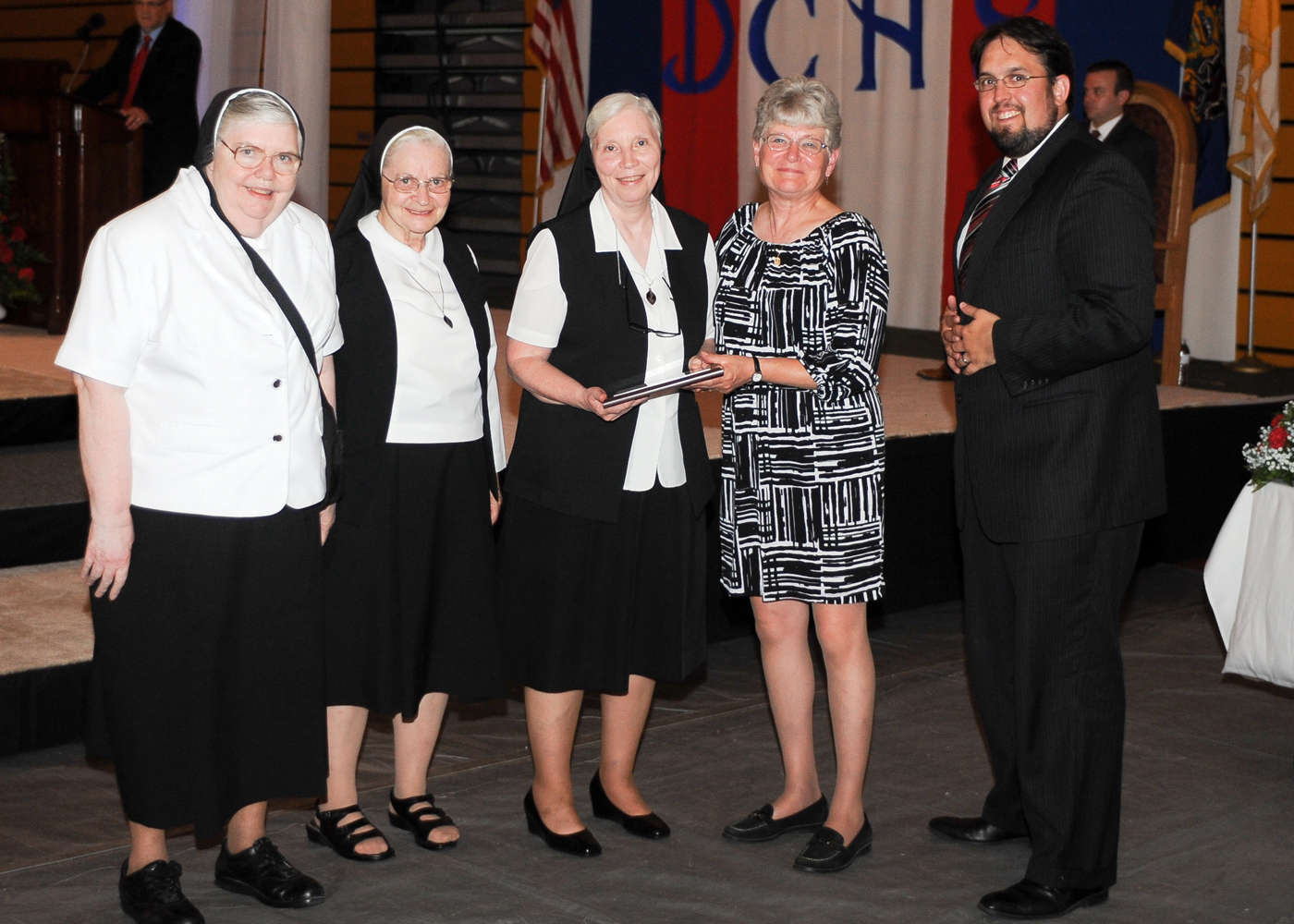 Sister Marilyn McCusker, a former faculty member, Sister Mary Mark Smith '58 and Sister Marie Pauline Demek, former principal at Annunciation B.V.M. School, accept induction on behalf of the Sisters of Christian Charity in Mendham, N.J.