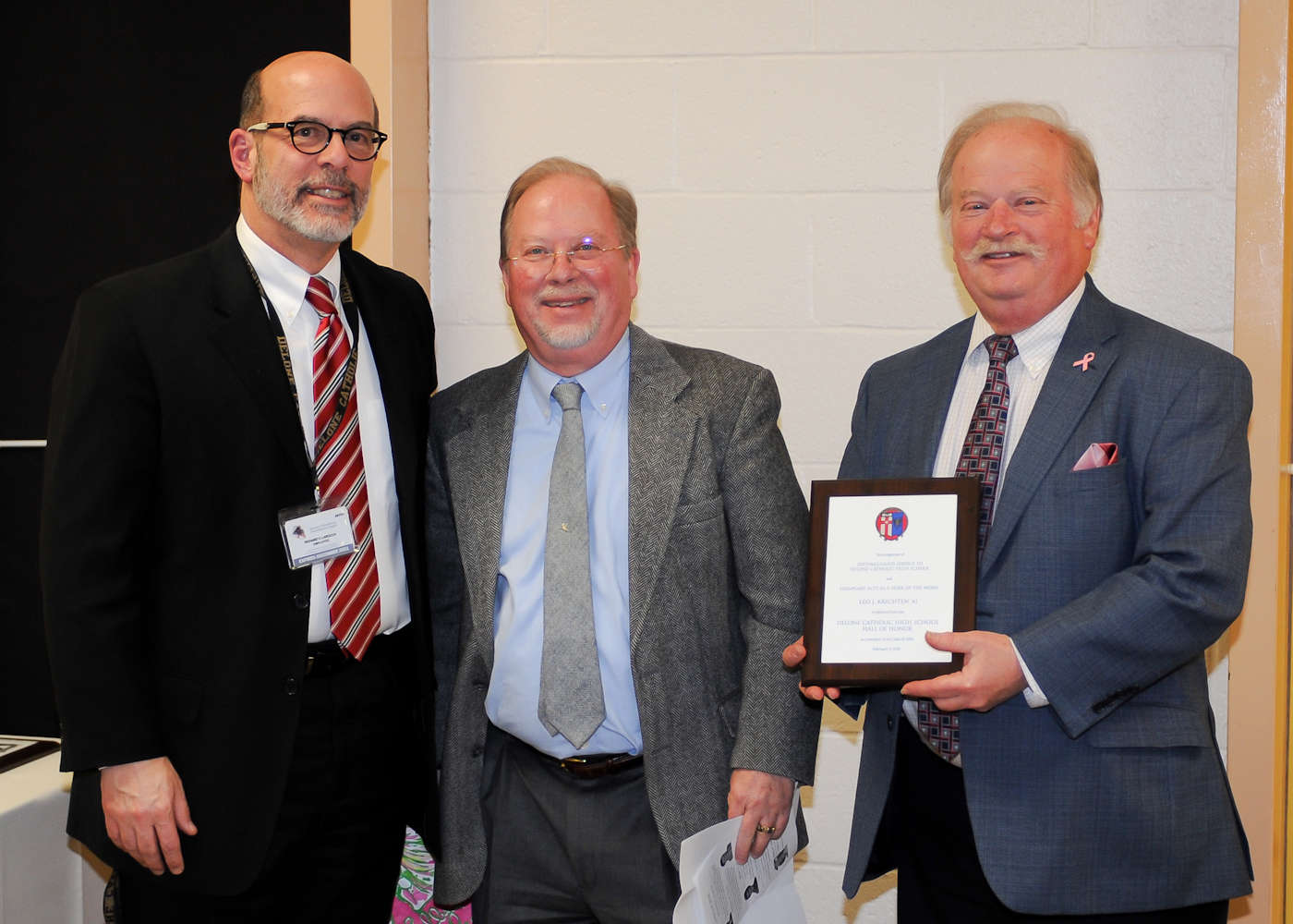 Richard C. Krichten '70 (center) and Michael A. Krichten '72 (right) accept induction into the Delone Catholic Hall of Honor on behalf of their father, Leo J. Krichten '41.