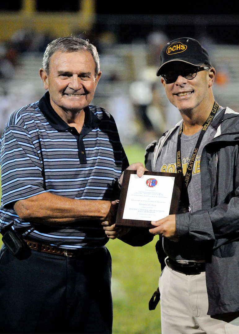 Unable to attend the induction ceremony, Dennis H. Frew accepted induction into the Delone Catholic Hall of Honor and made remarks by telephone. He received his plaque at the varsity football game on Aug. 31, 2018.