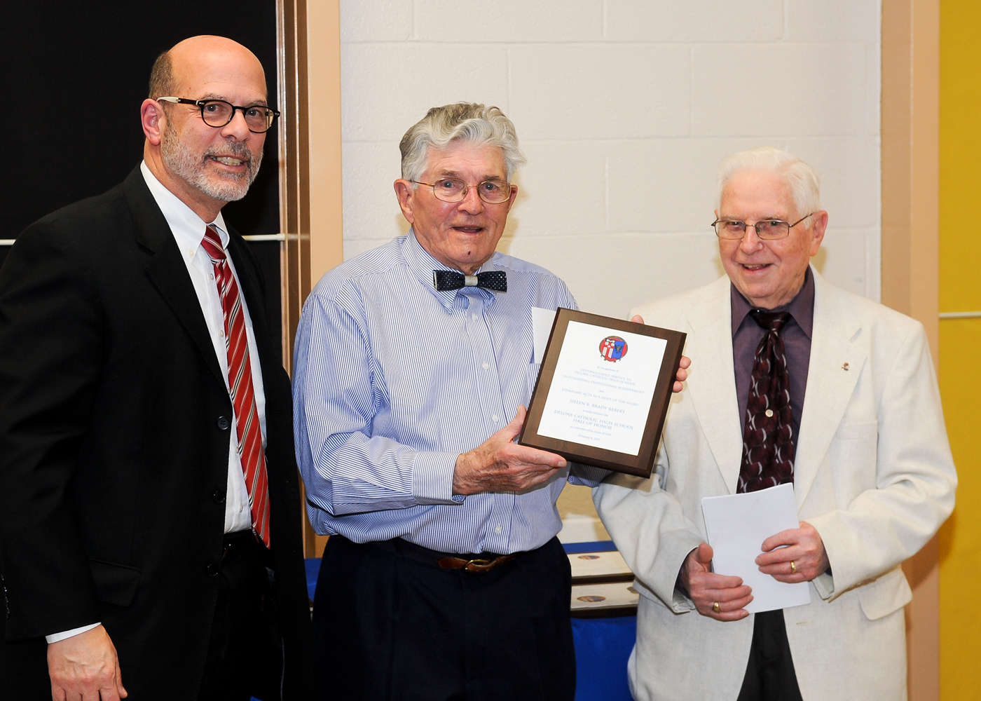 Donald R. Brady '48 (center) and Bernard C. Brady '50 (right) accept induction into the Delone Catholic Hall of Honor on behalf of their mother, Helen B. Brady Rebert.