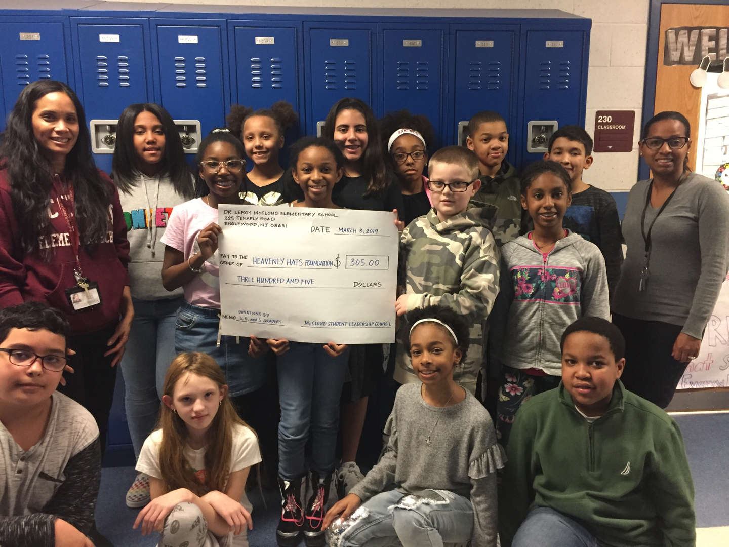 McCloud students with a big check for charity
