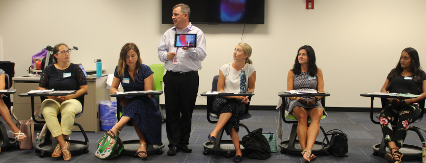 Chris Nelson trains new teachers in district's technology philosophy.