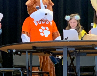 Students read lines for the mascots.