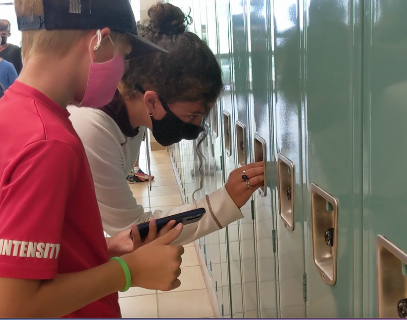 Homebase leader helps sixth grader with locker