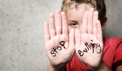 Child picture with Stop Bullying written on hands