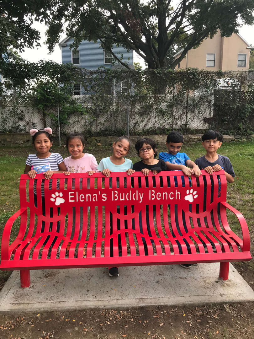 Jefferson Elementary School students show off their new Buddy Bench.