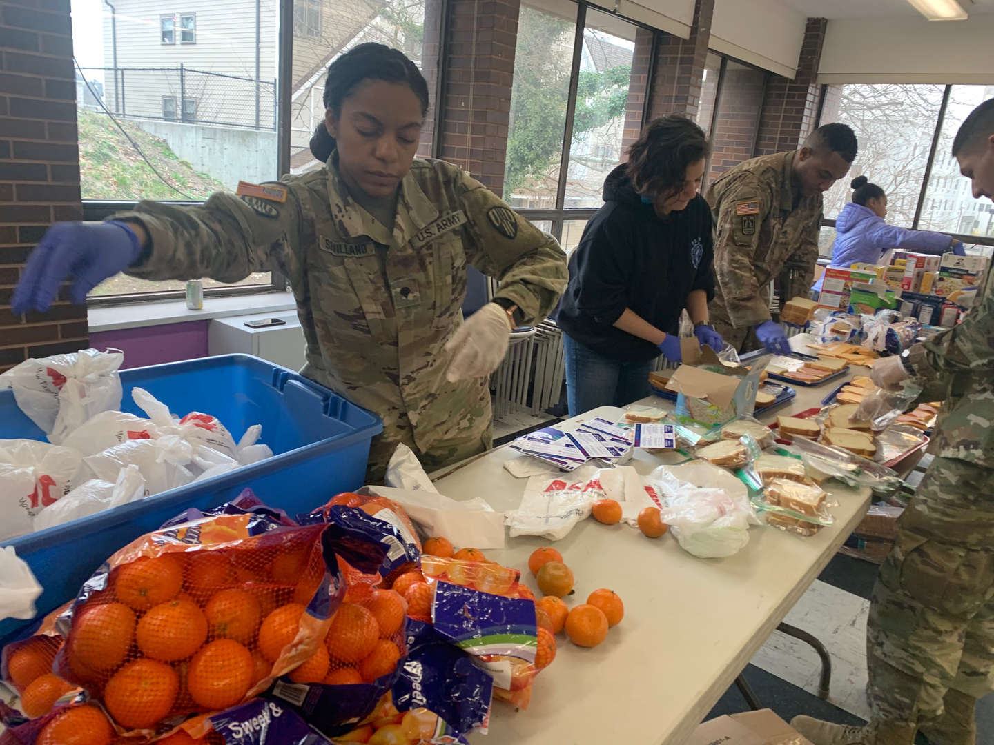 National Guard and local volunteers preparing meals at 95 Lincoln Ave.