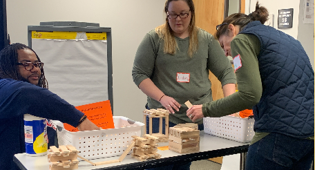 teachers engaged in purposeful play activity