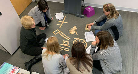 teachers engaged in a PD workshop