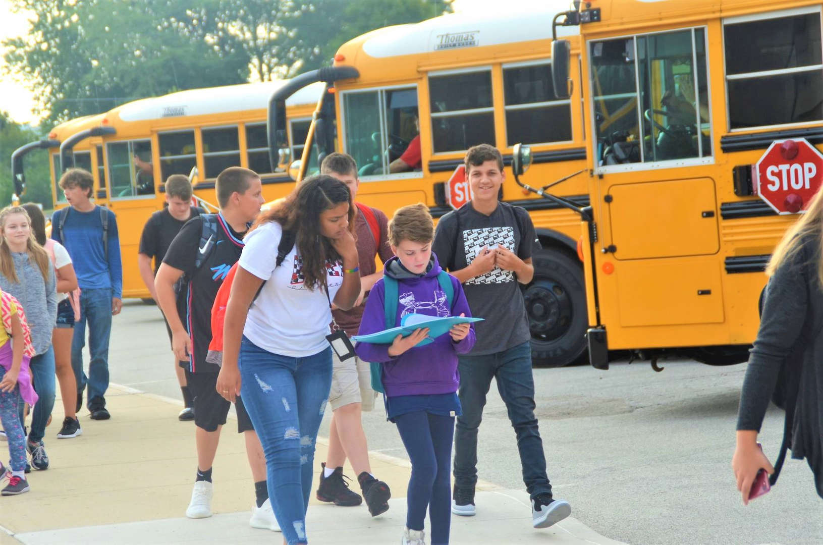 Students getting off the bus.