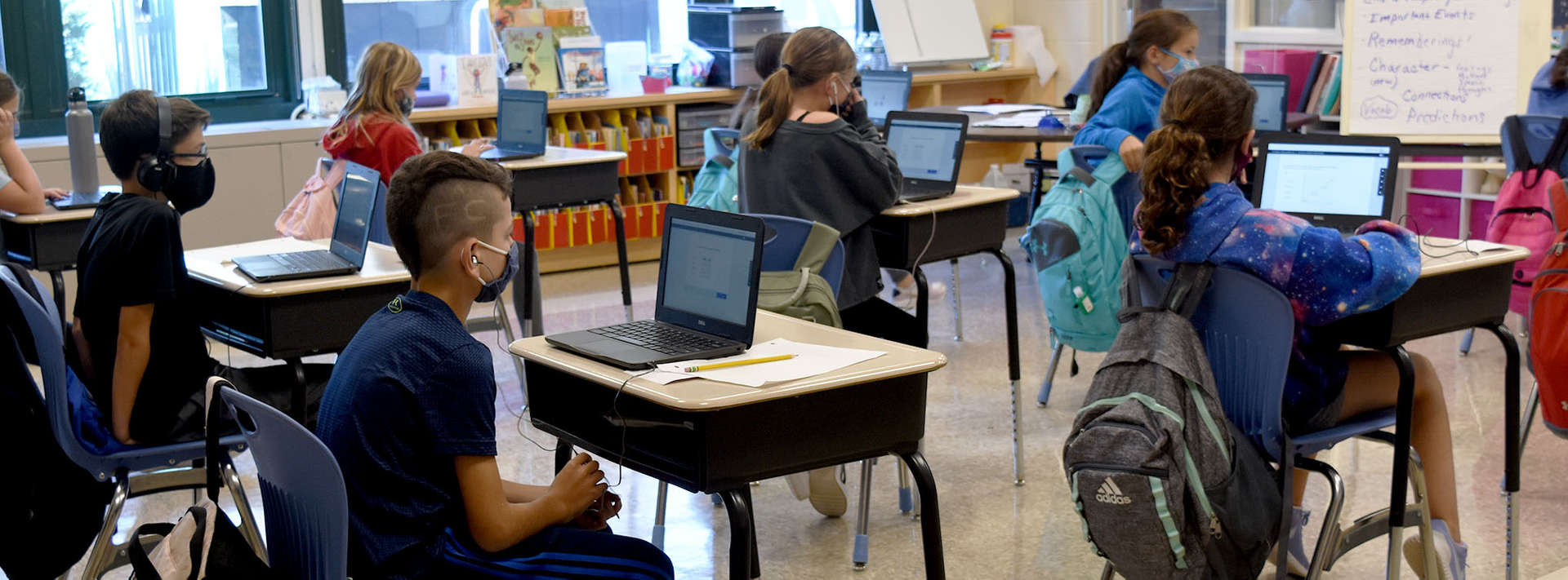 Class working on laptops at their desk.