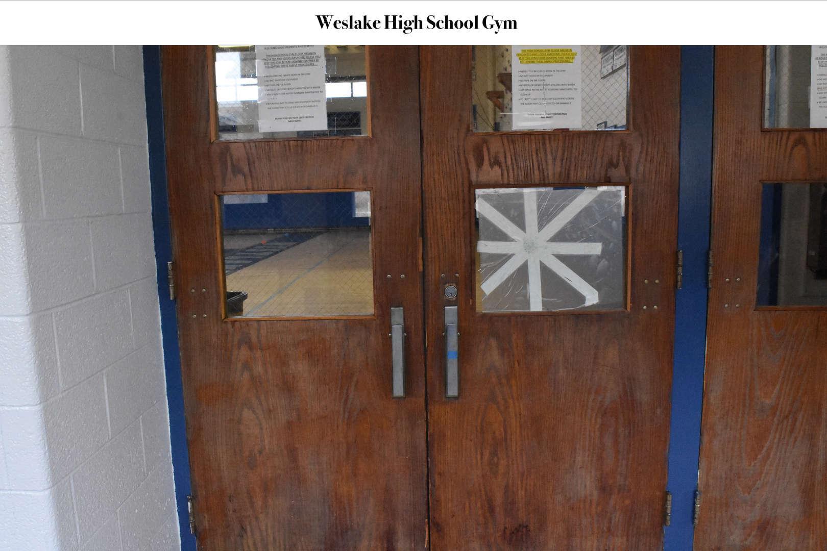 WHS Gym door with tape covering broken window