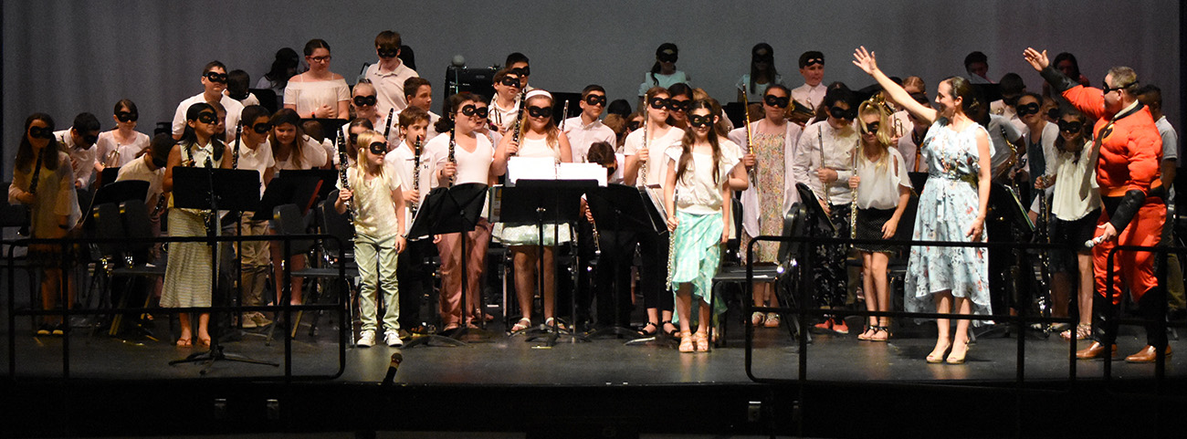 6th grade band takes a bow on stage